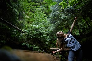 Blonde Woman dancing in the forest