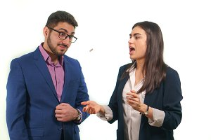 Business partners throw a coin a girl is surprised opened her mouth a guy concentrates looking at a coin
