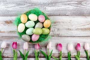 Colorful Easter Items on rustic wood