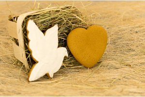 Gingerbread cookies in the form of a dove and heart. Valentine's Day.