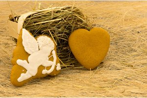 Gingerbread in the shape of cupid and heart. Valentine's Day.