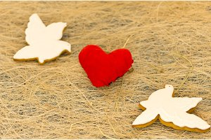 Love card. Two white pigeons and a red heart. Valentine's Day.