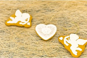 Gingerbread cookies in the form of cupids and hearts.