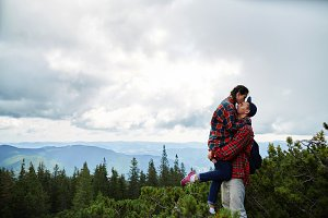 Couple kiss at mountains background