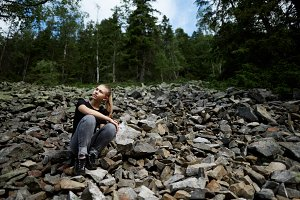 Blonde girl on the rocks