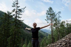 Woman feeling free at mountains