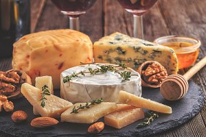 Cheese, nuts, grapes and red wine