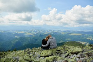 Young couple resting on mountains