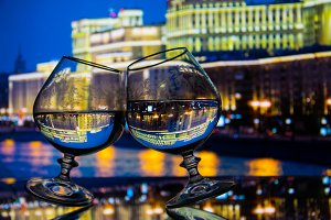 Two glasses with liquid night city b