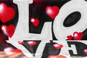 Word Love and hearts of spray paint