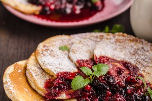 Crepes pancakes with berries reduction