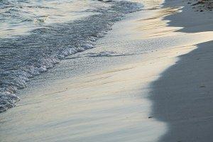 Wave on sand