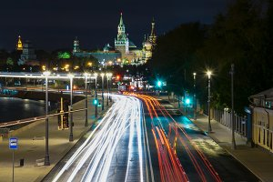 Street to kremlin in moscow at night blurred car lights