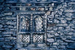 Blue stone wall with wood window. Background.
