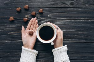 Cup of coffee and chocolate candy
