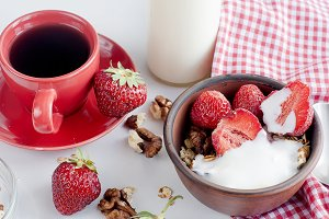Breakfast granola, strawberry and a