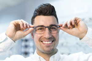 man trying on lenses