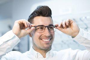 man trying on lenses