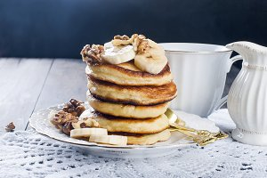 Pancakes with banana, nuts ,honey an