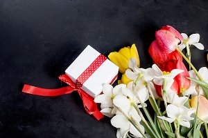 Bouquet of red tulips, daffodils and
