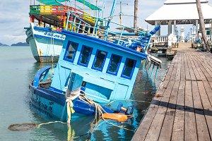 sunken fishing boat near the pier