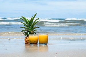 fresh summer drink with pineapple on a beautiful beach