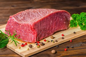 raw boneless beef meat with pepper