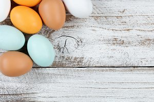 Natural Colorful Eggs on rustic wood
