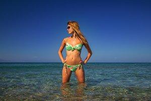 Caucasian woman in bikini standing in the sea