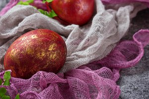 Easter painted red chicken eggs