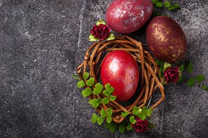Easter painted red eggs on nest