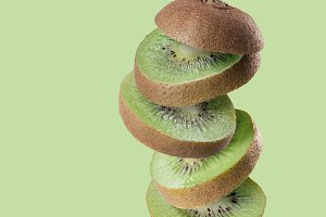 Falling slices of kiwi fruit isolated