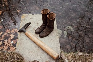 Still life of boots on lake