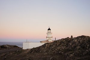 Light house on pink sunset