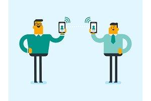 Two men exchanging information via smartphones.