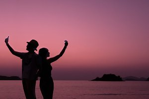 Silhouette of Couple taking Selfie