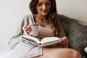 Beautiful woman reading a book.