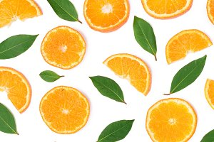 Slices of orange or tangerine with leaves isolated on white background. Flat lay, top view. Fruit composition