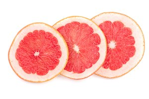Grapefruit slices isolated on white background. Top view