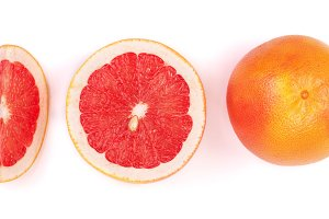 Grapefruit and slices isolated on white background. Top view. Set or collection