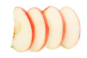 Apple slices isolated on white background close-up. Top view