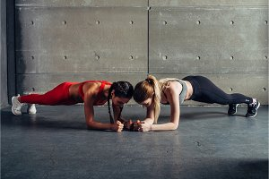 Two fit women doing plank exercise Fitness sport workout