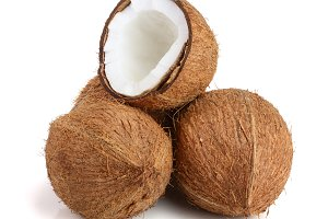 three whole coconut and half isolated on white background