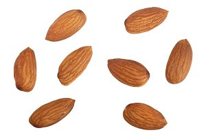 almonds isolated on white background without a shadow close up. Top view