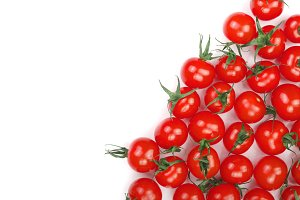 Cherry small tomatoes isolated on white background with copy space for your text. Top view. Flat lay