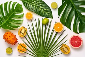 Tropical Palm Leaves and Fresh Fruit