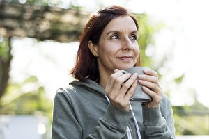 Woman having a mug of hot coffee