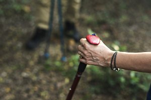 Woman using a trekking pole