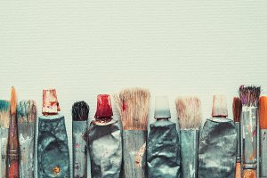 Artist paintbrushes and paint tubes
