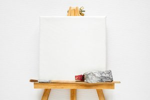 Canvas, easel, tube of paint, brush.